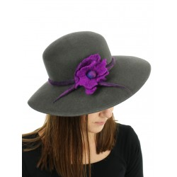 Gray felt hat with a wide brim, decorated with a sprig of flowers