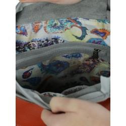 Orange backpack with a handbag function.