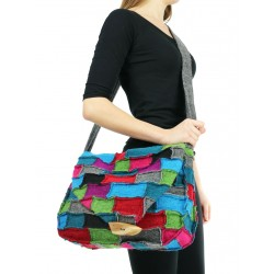 A patchwork shoulder bag made of small colored pieces of steamed wool