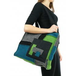 A patchwork shoulder bag made of small colored pieces of steamed wool and linen