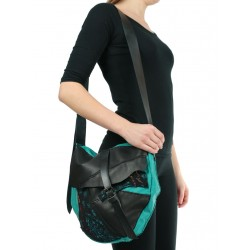 Large women's leather shoulder bag with an artistic touch