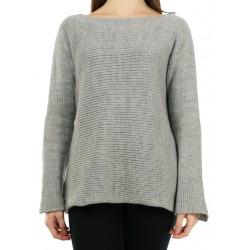 Simple gray oversize sweater made by hand from woolen yarn