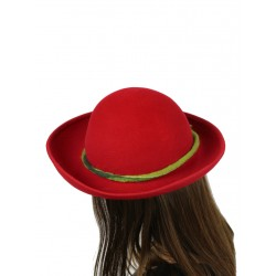 A handmade red hat with an turned up brim