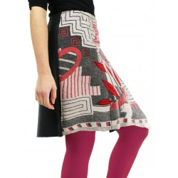 Wrap skirt with hand-embroidered patterns.