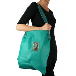Large hand-sewn leather handbag in turquoise color