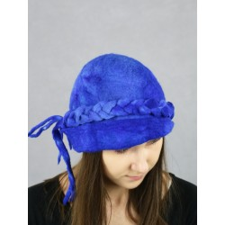 Hand-felted hat with a decorative braid.