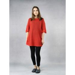 Orange knitted linen blouse.
