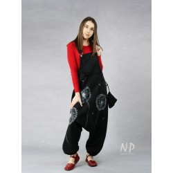 Black dungarees with a lowered crotch made of natural linen.