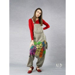 Hand-painted linen dungarees with lowered crotch in natural linen color