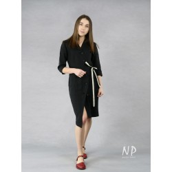 Black dress with a zipper tied on the side of a shirtdress.