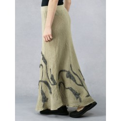 A long linen skirt made of a bias with sewn-on flowers