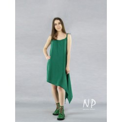 A green linen dress with tied straps with an elongated side