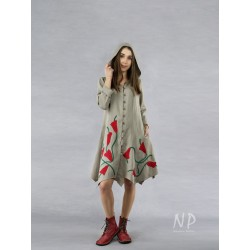 A buttoned linen coat dress with a hood, decorated with sewn-on flowers