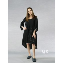 Black dress with a longer back, decorated with white stitching