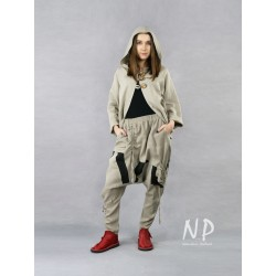 Linen trousers with a lowered crotch and tapered legs