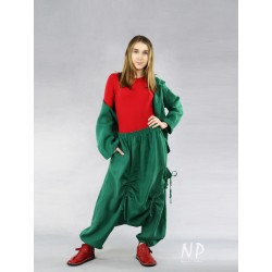 Green linen pants with a lowered crotch, finished with a belt on an elastic band, decorated with strings