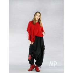 Black linen pants with a lowered crotch, painted with poppies, finished with an elastic band