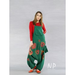 Green dungarees with a lowered crotch made of natural linen.