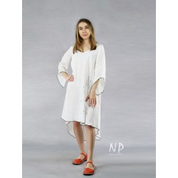 White linen dress with a longer back, decorated with black stitching