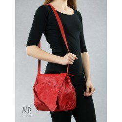 Unique, hand-sewn from natural leather, red bag-type sack