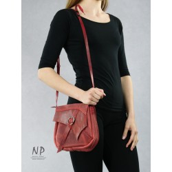 Dark red small handmade leather handbag, handcrafted by a plastic artist