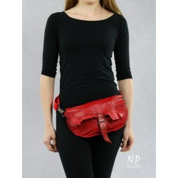 A red women's sachet made by hand from natural leather