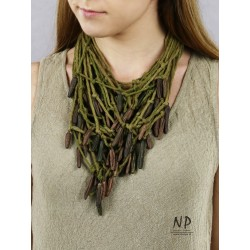 Green cord necklace with ceramic icicle ornaments.