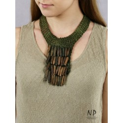 Handmade necklace of linen threads, decorated with golden-colored ceramic icicles