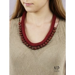 Handmade necklace made of cotton string, decorated with ceramic beads