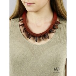 Handmade necklace made of cotton string, decorated with flat clay beads