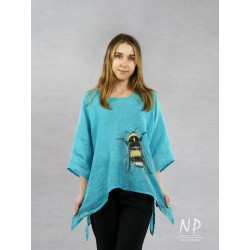 Turquoise and blue linen blouse with elongated sides, decorated with a hand-painted bee
