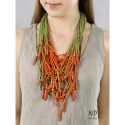In green and orange colors, a handmade necklace made of cotton strings and ceramic ornaments