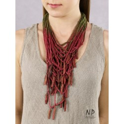 In the colors of dark pink and green, a handmade necklace made of cotton strings and ceramic ornaments