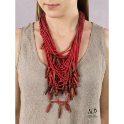 Red handmade necklace made of cotton strings and ceramic ornaments