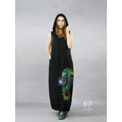 Black linen dress with a hood decorated with a hand-painted face in contrasting colors