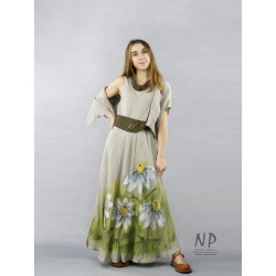 A linen dress with straps in the color of natural linen, hand-painted with flowers, made of a slant.