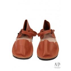 Flat red-orange women's sandals made in the Trek workshop