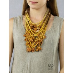 Yellow and brown handmade necklace made of linen and cotton strings, decorated with ceramic beads