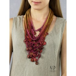 Handmade colorful necklace, made of linen and cotton strings, decorated with ceramic beads