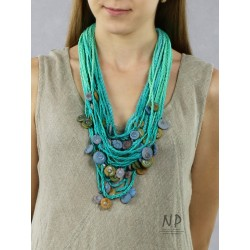 Handmade turquoise necklace, made of linen and cotton strings, decorated with ceramic beads