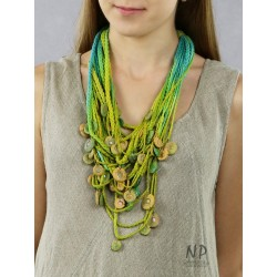 Handmade yellow-green-turquoise necklace, made of linen and cotton strings, decorated with ceramic beads