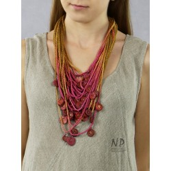 Handmade colorful necklace, made of linen braided strings, decorated with ceramic beads