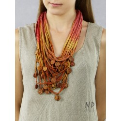 Handmade colorful necklace, made of braided strings, decorated with ceramic beads