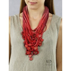 Handmade red necklace, made of braided strings, decorated with ceramic beads