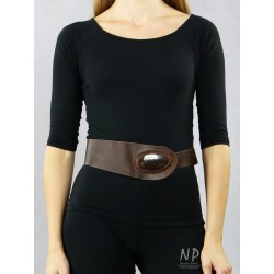 A brown wide decorative belt made of natural leather, decorated with hand-made ceramics