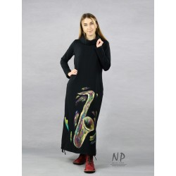 Long black knitted turtleneck dress decorated with hand-painted saxophone