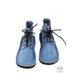 Hand-sewn higher leather boots in denim color, laced with a thong