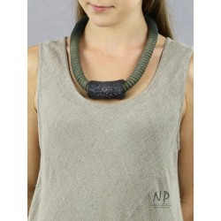 Gray string necklace with a ceramic tube-shaped ornament.
