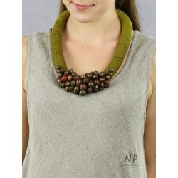 In green colors, a handmade necklace made of thick cotton string, decorated with ceramic beads