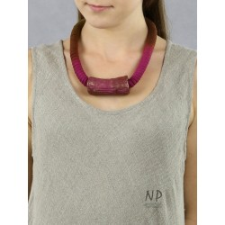 Necklace made of dyed cotton string and a decorative ceramic tube
